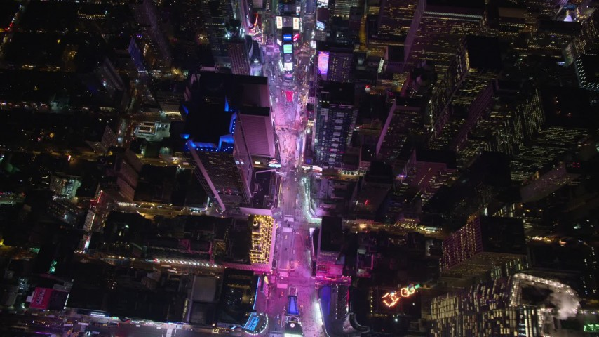 5.5K stock footage aerial video tilt to bird's eye of Times Square at Night in Midtown Manhattan, NYC Aerial Stock Footage | AX122_176E