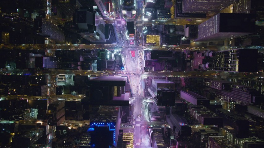 6K aerial video of a bird's eye view of Times Square at Night in Midtown Manhattan, New York City Aerial Stock Footage | AX122_177