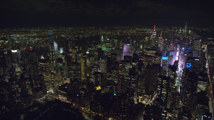 6K stock footage aerial video of Midtown skyscrapers and famous Times Square at Night in NYC Aerial Stock Footage | AX122_182