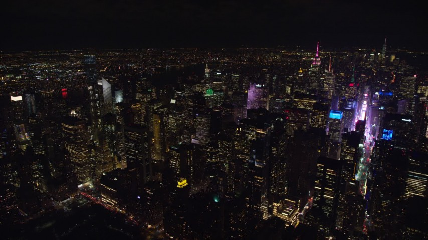 5.5K stock footage aerial video of Midtown skyscrapers and famous Times Square at Night in NYC Aerial Stock Footage   AX122_182E