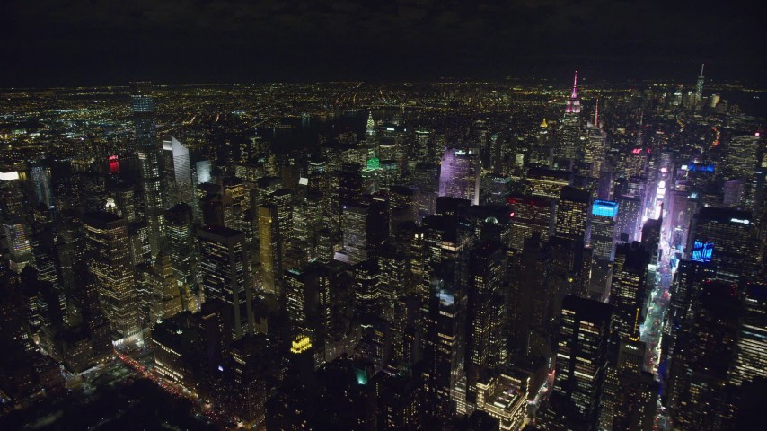 6K stock footage aerial video of a wide view of Midtown high-rises and Times Square at Night in NYC Aerial Stock Footage | AX122_183