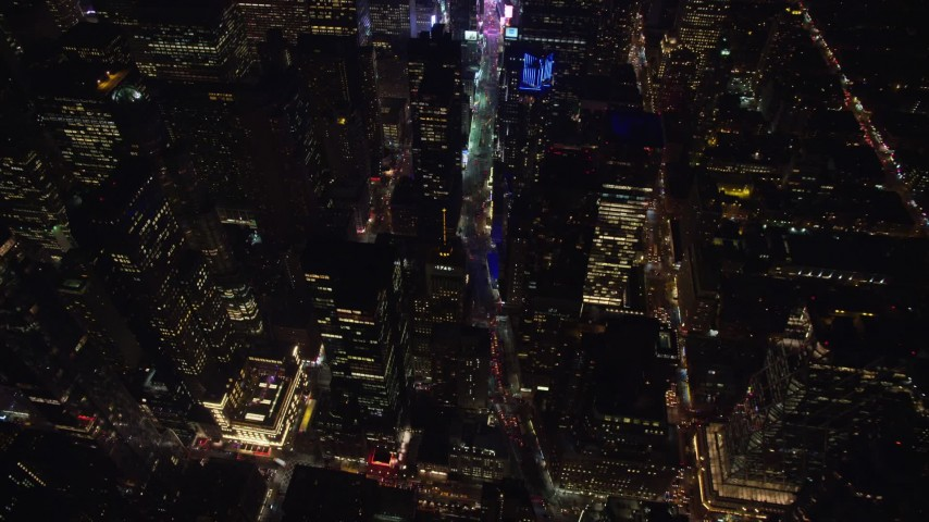 Approach and Tilt Down to Broadway in Midtown at Night Aerial Stock Footage | AX122_184