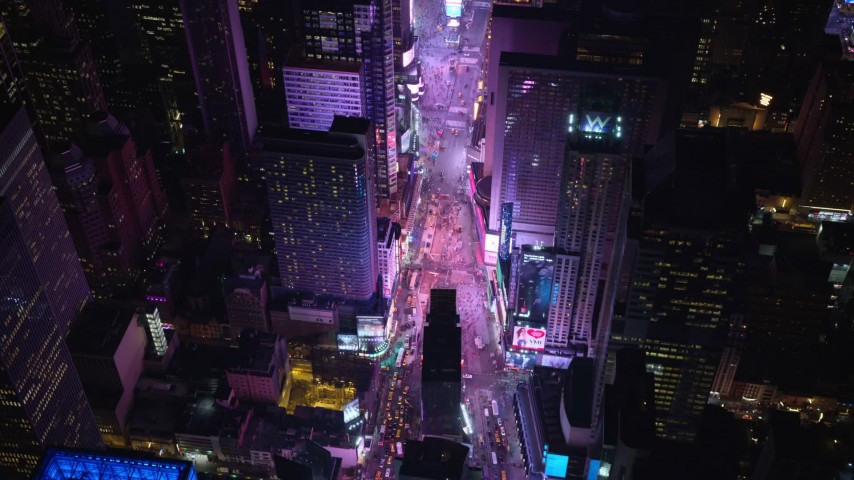 5.5K stock footage aerial video of heavy traffic through Times Square at Night in Midtown Manhattan, New York City Aerial Stock Footage | AX122_185E