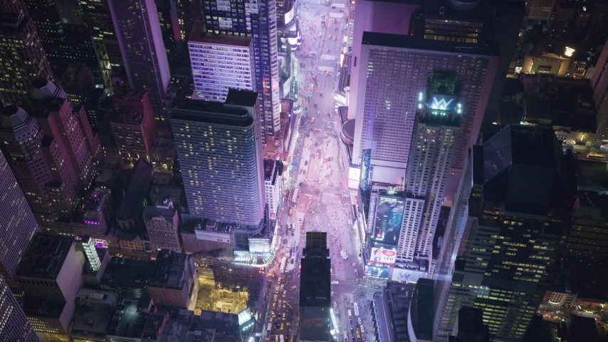 6K stock footage aerial video of heavy traffic in famous Times Square at Nighttime, Midtown Manhattan, NYC Aerial Stock Footage | AX122_186