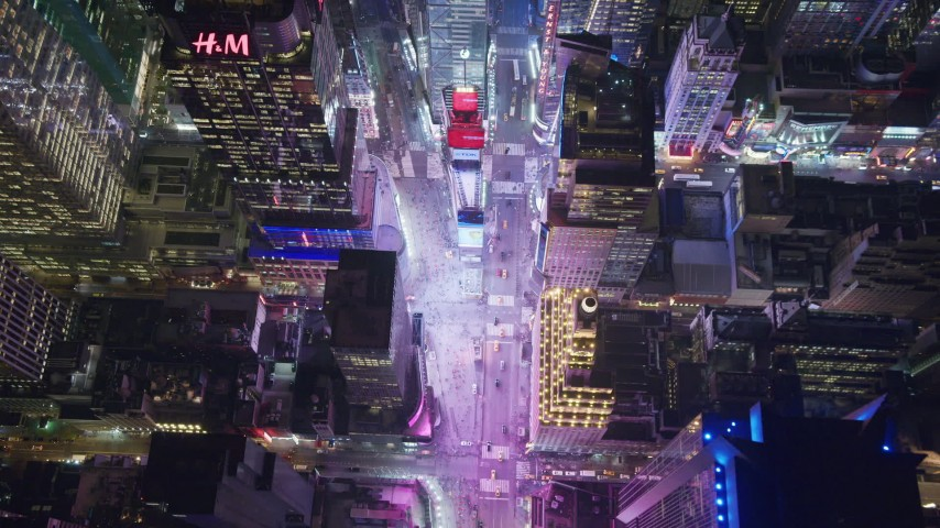 6K stock footage aerial video tilt to bird's eye view of famous Times Square at Night in Midtown, NYC Aerial Stock Footage | AX122_187