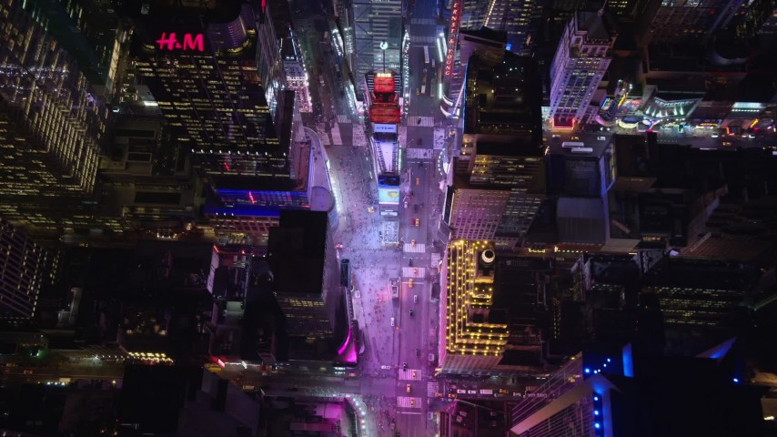5.5K stock footage aerial video tilt to bird's eye view of famous Times Square at Night in Midtown, NYC Aerial Stock Footage | AX122_187E