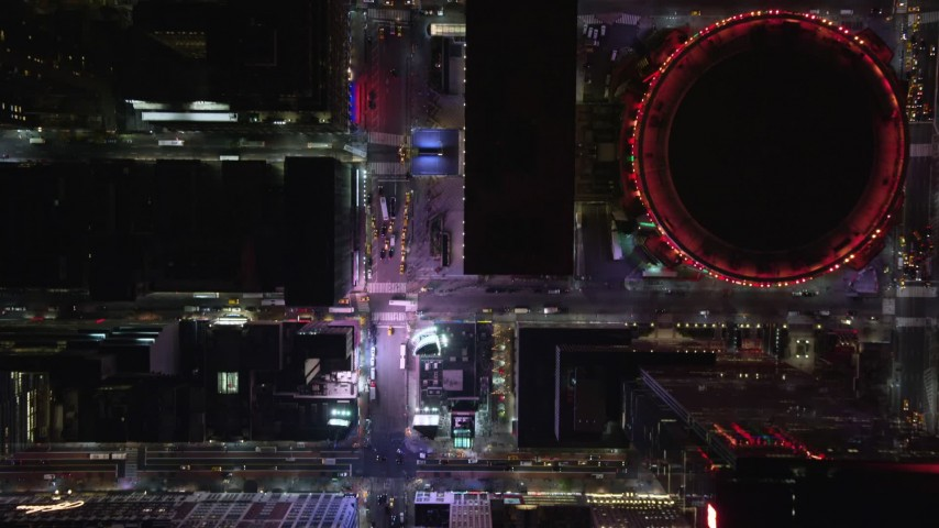 5.5K stock footage aerial video of light traffic on 7th Ave, reveal Madison Square Garden in Midtown, NYC at Night Aerial Stock Footage | AX122_189E