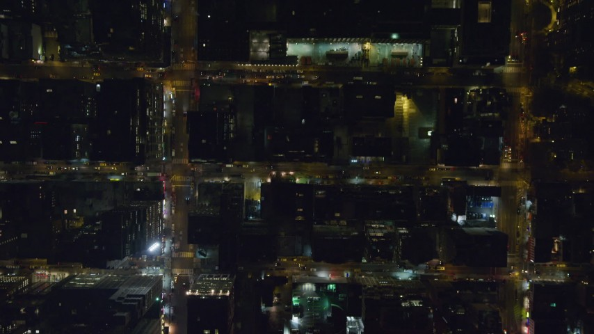 6K stock footage aerial video bird's eye view of Madison Square Garden and streets in Midtown at Night, NYC Aerial Stock Footage | AX122_191