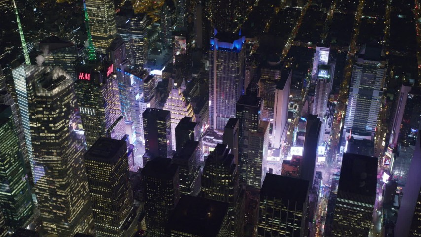 6K aerial video orbit of Times Square and skyscrapers in Midtown Manhattan, New York City at Night Aerial Stock Footage AX122_198