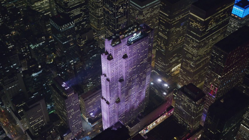 6K stock footage aerial video of an orbit of Rockefeller Center at Night in Midtown Manhattan, New York City Aerial Stock Footage | AX122_199