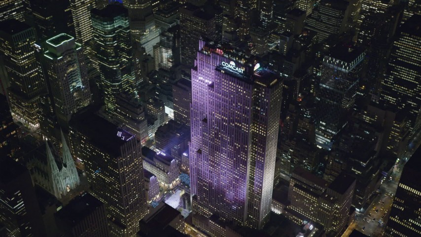Orbit Rockefeller Center with Ice Rink at Night in Midtown Aerial Stock Footage | AX122_201