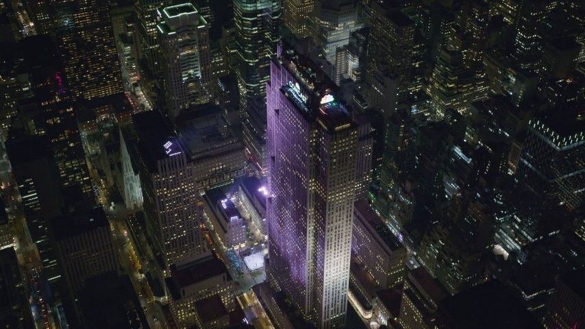 6K stock footage aerial video of circling around Rockefeller Center with ice rink at Night in Midtown, NYC Aerial Stock Footage | AX122_202