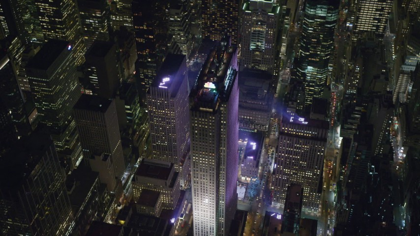 6K stock footage aerial video of Rockefeller Center at Night in Midtown Manhattan, New York City Aerial Stock Footage | AX122_203