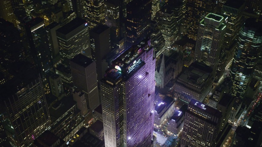 6K stock footage aerial video of orbiting the top of Rockefeller Center at Night in Midtown, New York City Aerial Stock Footage | AX122_204