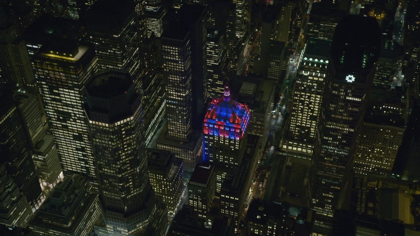 6K stock footage aerial video orbit the Helmsley Building in Midtown, New York City at Night Aerial Stock Footage | AX122_205