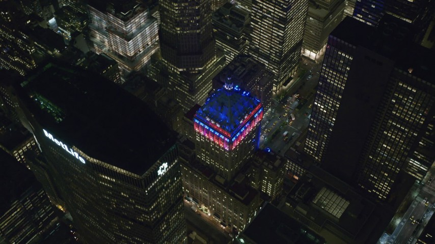 6K stock footage aerial video of orbiting around the Helmsley Building and MetLife Building at Night in Midtown, NYC Aerial Stock Footage | AX122_207