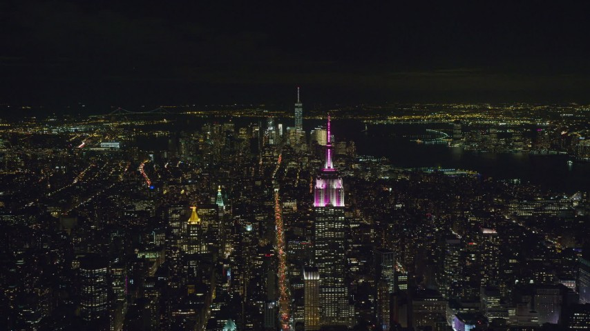 6K stock footage aerial video of the Empire State Building and Lower Manhattan at Night in New York City Aerial Stock Footage | AX122_211