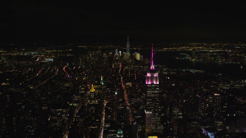 5.5K stock footage aerial video of the Empire State Building and Lower Manhattan at Night in New York City Aerial Stock Footage | AX122_211E