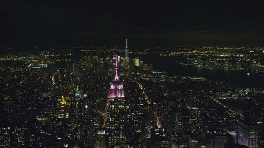 6K stock footage aerial video of Empire State Building with Lower Manhattan at Night in NYC Aerial Stock Footage | AX122_212