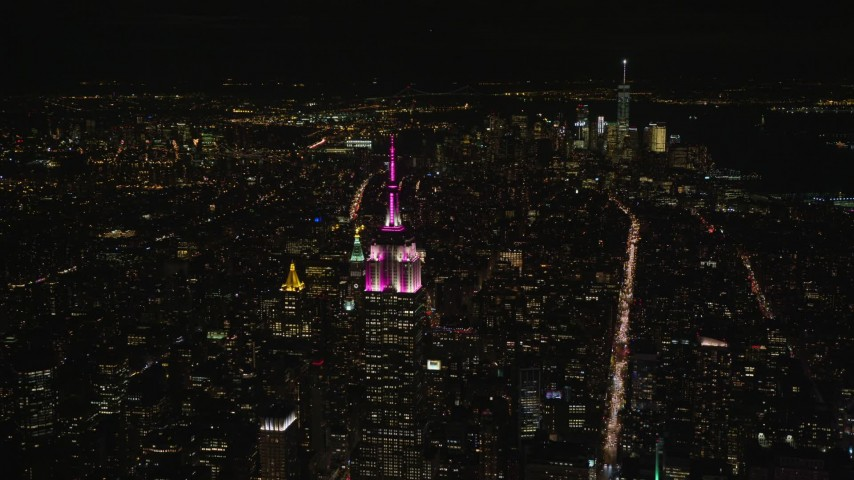 Orbit Empire State Building with View of Lower Manhattan at Night Aerial Stock Footage | AX122_213