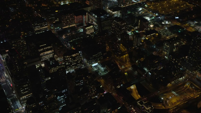 6K stock footage aerial video of apartment and office buildings in Midtown Manhattan, New York City at Night Aerial Stock Footage | AX122_214