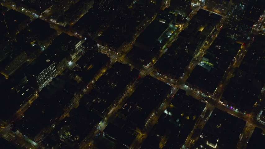 6K stock footage aerial video of orbiting Hell's Kitchen streets at Night in Midtown, New York City Aerial Stock Footage | AX122_217
