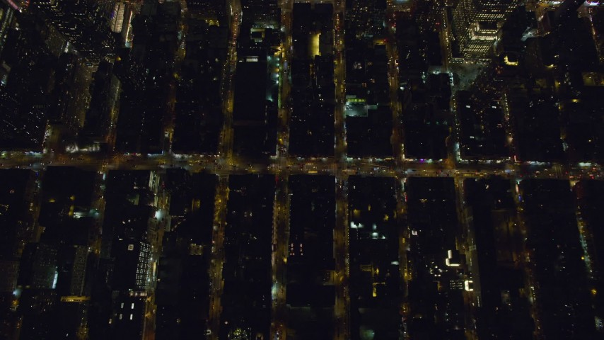6K stock footage aerial video of a bird's eye of Hell's Kitchen streets at Night in Midtown Manhattan, New York City Aerial Stock Footage | AX122_218