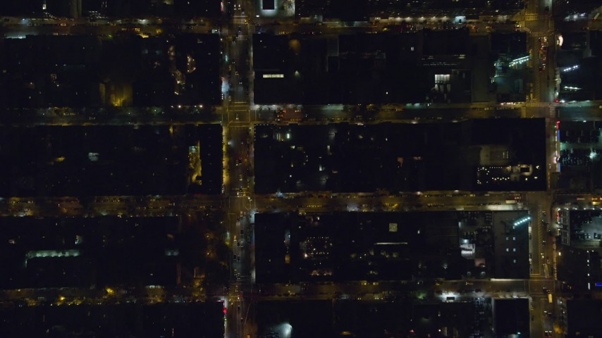6K stock footage aerial video bird's eye view of Hell's Kitchen streets at Night in Midtown Manhattan, New York City Aerial Stock Footage | AX122_219