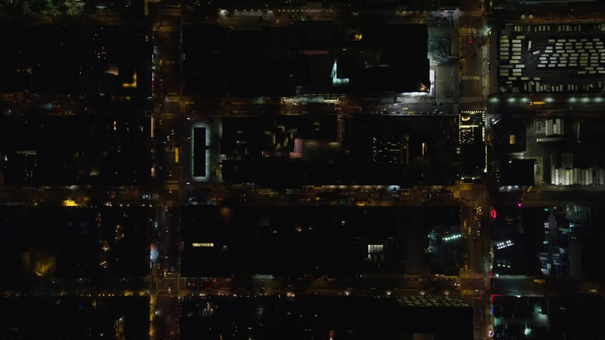 5.5K stock footage aerial video bird's eye view of Hell's Kitchen streets at Night in Midtown Manhattan, New York City Aerial Stock Footage | AX122_219E