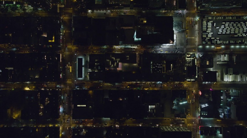 Bird's Eye View of Traffic on Hell's Kitchen Streets at Night Aerial Stock Footage | AX122_220