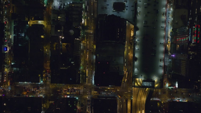 6K stock footage aerial video of a bird's eye of 42nd and 43rd streets at Night in Midtown Manhattan, New York City Aerial Stock Footage | AX122_222