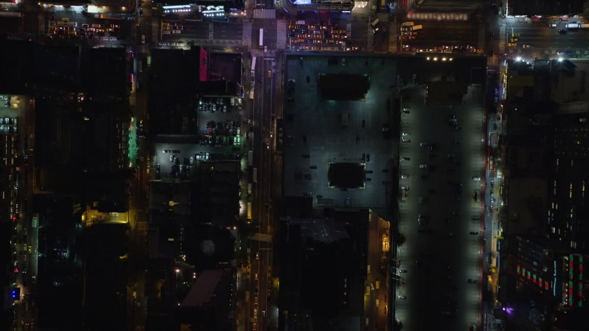 5.5K stock footage aerial video of a bird's eye of 42nd and 43rd streets at Night in Midtown Manhattan, New York City Aerial Stock Footage | AX122_222E