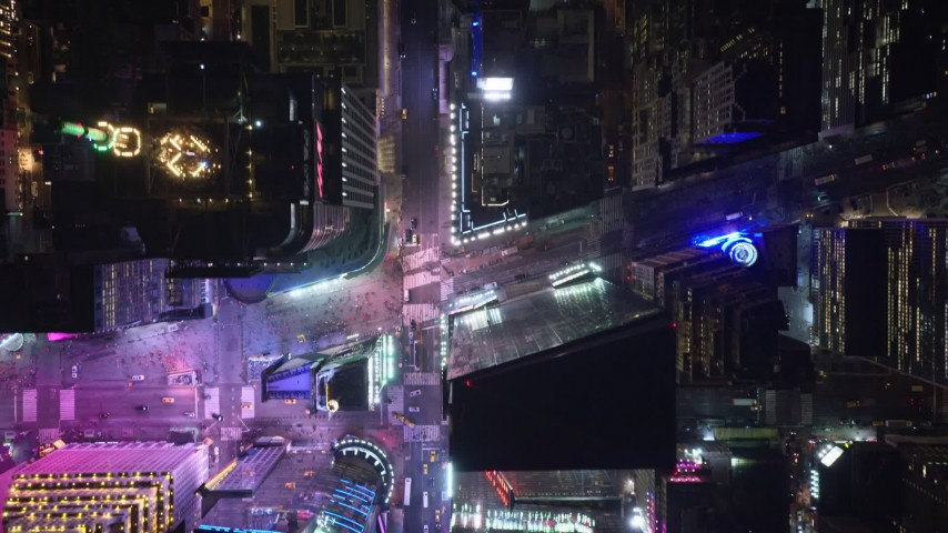 5.5K stock footage aerial video of a bird's eye view of 42nd Street revealing Times Square at Night, Midtown Manhattan, NYC Aerial Stock Footage | AX122_224E