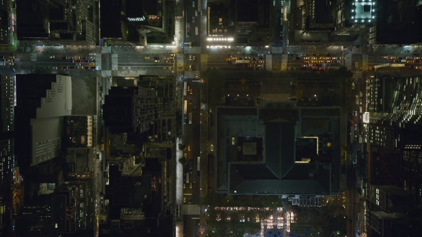 6K stock footage aerial video of bird's eye of 42nd Street and Bryant Park at Night in Midtown, New York City Aerial Stock Footage | AX122_226