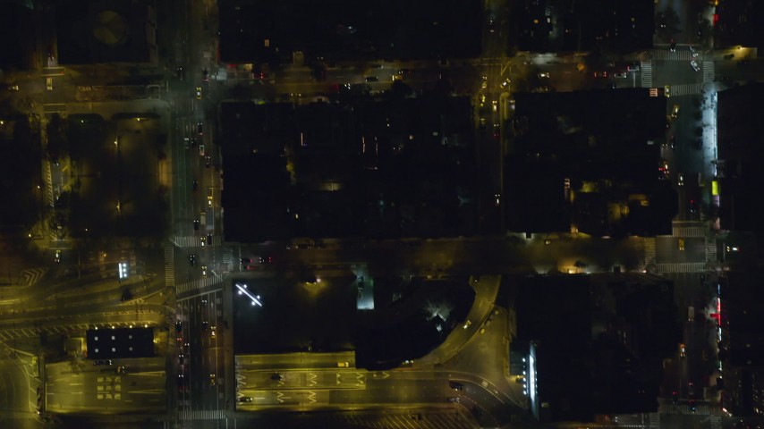 6K stock footage aerial video of bird's eye of city streets through Midtown at Night in New York City Aerial Stock Footage | AX122_228
