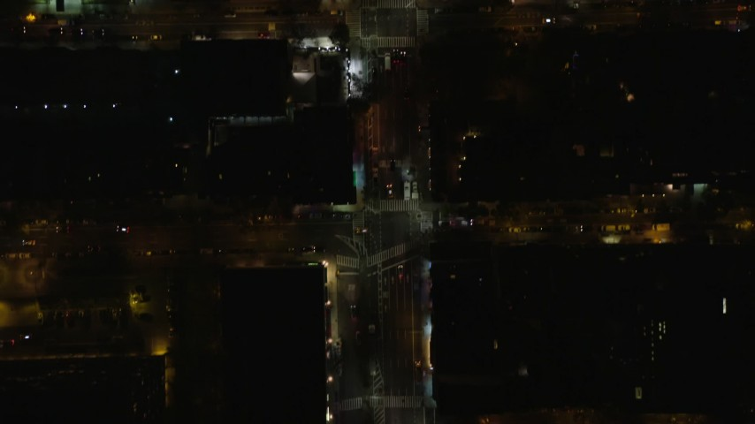 5.5K stock footage aerial video of bird's eye of city streets through Midtown at Night in New York City Aerial Stock Footage | AX122_228E