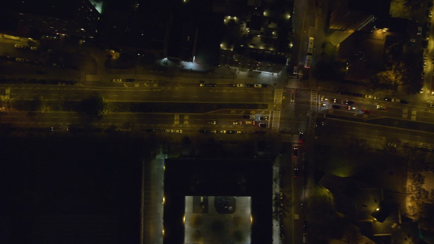 6K stock footage aerial video of a bird's eye of Houston Street at Night in East Village, NYC Aerial Stock Footage | AX122_255