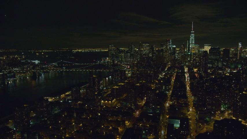 6K stock footage aerial video orbit Manhattan Bridge and Lower Manhattan at Night in New York City Aerial Stock Footage | AX122_256