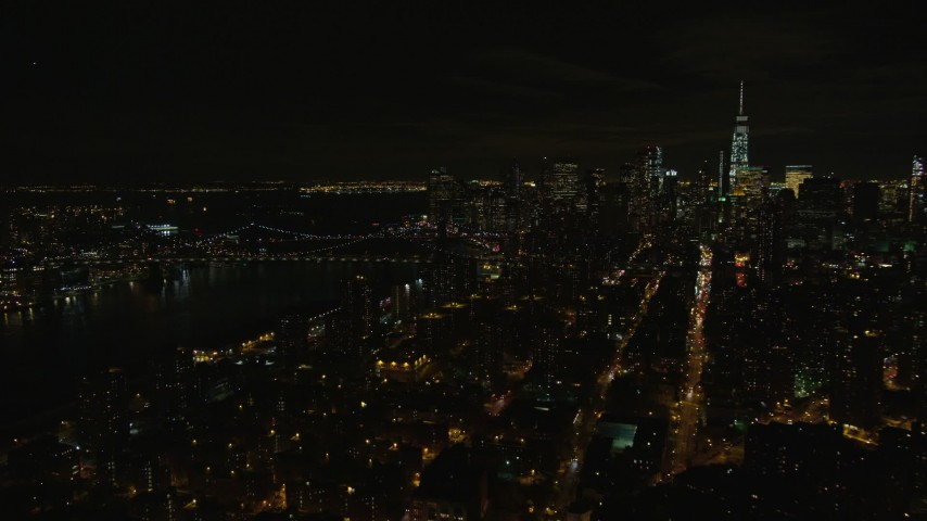 5.5K stock footage aerial video orbit Manhattan Bridge and Lower Manhattan at Night in New York City Aerial Stock Footage | AX122_256E