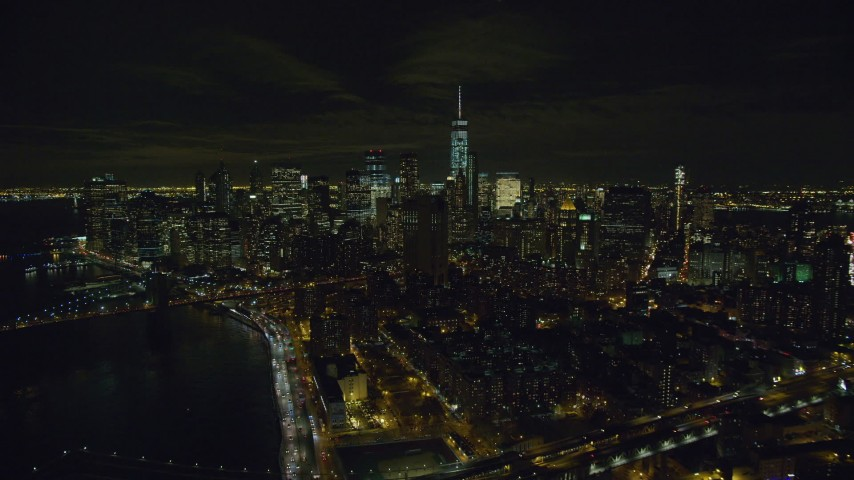 6K stock footage aerial video of Lower Manhattan seen from Manhattan Bridge at Night in NYC Aerial Stock Footage | AX122_259