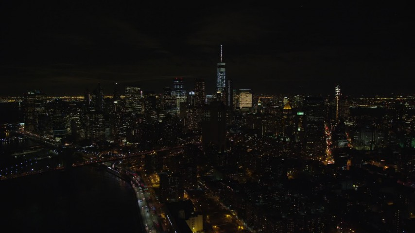 5.5K stock footage aerial video of Lower Manhattan seen from Manhattan Bridge at Night in NYC Aerial Stock Footage | AX122_259E