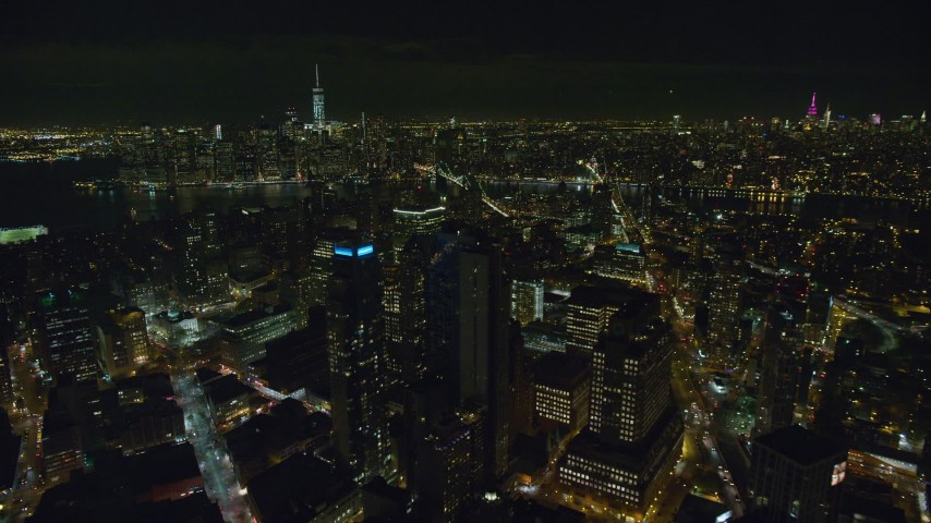 6K stock footage aerial video of flying by Brooklyn skyscrapers at Night in New York City, Lower Manhattan in distance Aerial Stock Footage | AX122_273