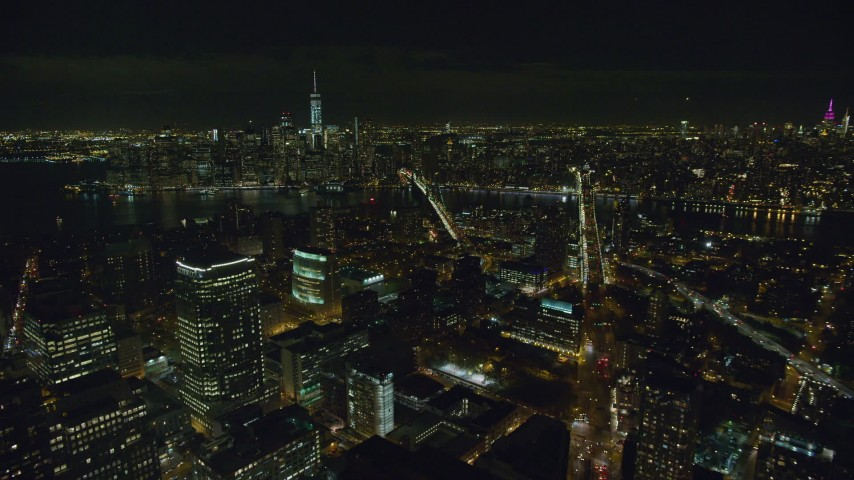 6K stock footage aerial video flyby Brooklyn skyscrapers toward East River at Night in New York City Aerial Stock Footage | AX122_274