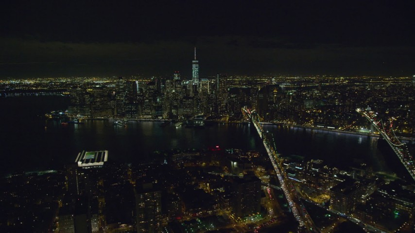 6K stock footage aerial video fly over Brooklyn toward Lower Manhattan at Night in New York City Aerial Stock Footage | AX122_276