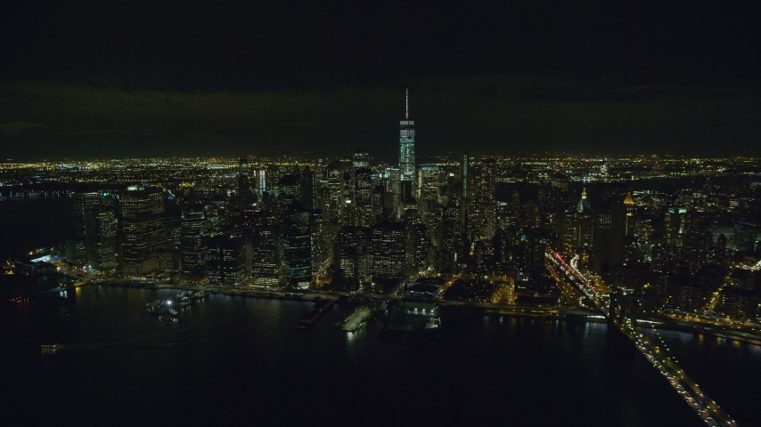 6K stock footage aerial video of crossing the river to approach Lower Manhattan from Brooklyn at Night in NYC Aerial Stock Footage | AX122_278