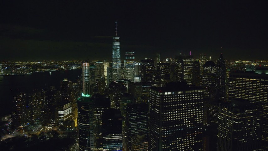 6K stock footage aerial video orbit riverfront towers and reveal Freedom Tower in Lower Manhattan at Night, NYC Aerial Stock Footage | AX122_282