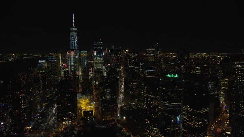 5.5K stock footage aerial video orbit riverfront towers and reveal Freedom Tower in Lower Manhattan at Night, NYC Aerial Stock Footage | AX122_282E