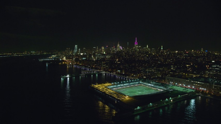 6K stock footage aerial video of Midtown skyscrapers seen from Pier 40 in Greenwich Village at Night, New York City Aerial Stock Footage | AX122_289