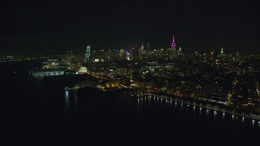 Midtown Skyscrapers and Piers in Chelsea at Night in NYC Aerial Stock Footage | AX122_291
