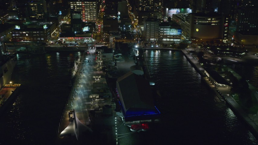 6K stock footage aerial video of an orbit of USS Intrepid in Hell's Kitchen, Midtown at Night in NYC Aerial Stock Footage | AX123_004